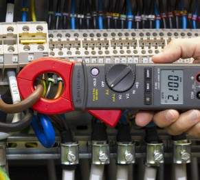 41845711 - electrician measuring current with current clamp.